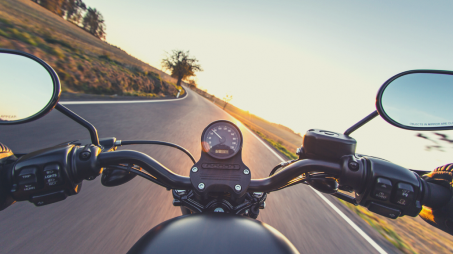 The secrets to more purpose and profitability - point-of-view riding motorbike into the sunset